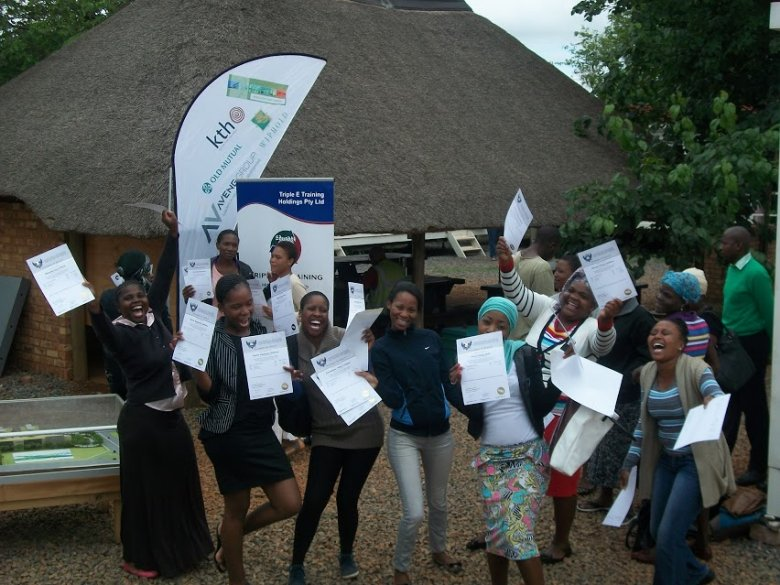 Abet Learners receiving certificates