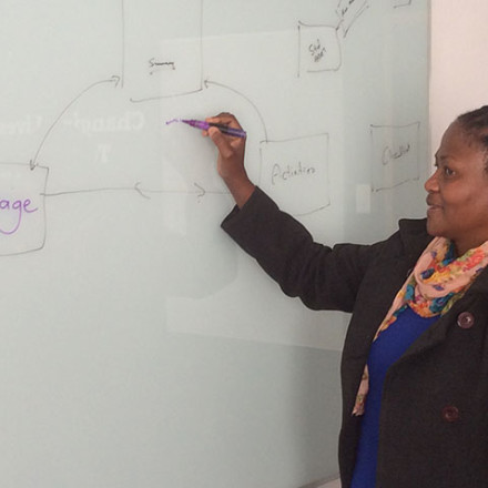 abet tutor writing on white-board